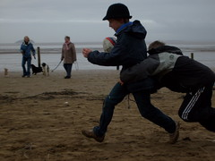 Rugby on the beach (dandavie) Tags: playing beach fun rugby tackle