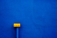 Yellow at any time. (Ian McWilliams.) Tags: blue abstract colour sign yellow wall emotion artistic small vivid minimal cumbria bland minimalistic less barrow bold lessismore colourartaward