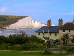 The Coast Guard Cottages at Seven Sisters coming from Seaford Head (UGArdener) Tags: england coastguard cliff english beautiful walking sussex village unitedkingdom britain hiking cliffs sevensisters seaford southdowns seacoast nesting cottages cuckmerehaven seafordhead shinglebeach coastguardcottages seabreezes kitiwakes chalkcloffs englishtravel
