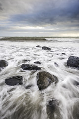 Stone Washed (Stephen_Lavery) Tags: belfastlough blackhead countyantrim ireland northantrimcoast northernireland stephenlavery whitehead boulders cloud coast coastal horizon lighthouse ocean rocks sea seashore sentinel shoreline sky tidal tide warning wash wavelet waves