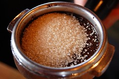 Ground espresso with raw sugar