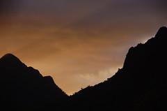 Kualoa Sunset: Orange (AH in Pgh) Tags: sunset orange mountains silhouette clouds hawaii oahu lightbeams koolaumountains windwardoahu kualoapark camerahaiku kualoaregionalpark