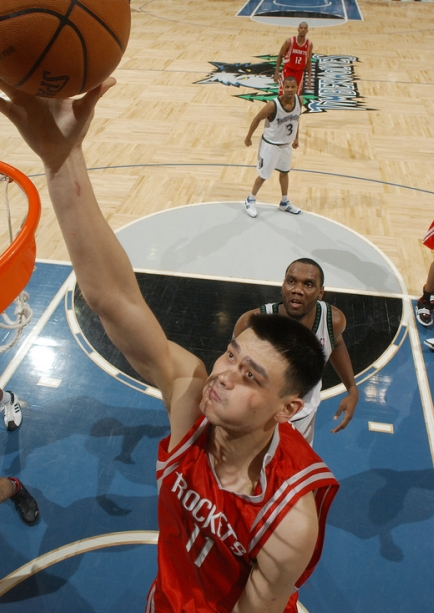 Yao Ming scores with Minnesota's Al Jefferson looks on Monday night in Minnesota.  Yao would only score 16 points and grab 5 boards in a game that went down to the wire, which the Rockets won 92-86.