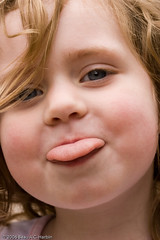 Girl sticks out tongue (BACHarbin) Tags: family portrait usa girl tongue female happy kid eyes child blueeyes nm youngster playful stickingouttongue stickingtongueout glorieta submittedtophotoshelter