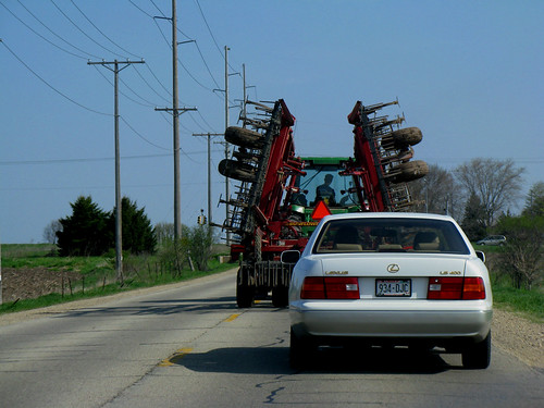 Lexus behind the Deere