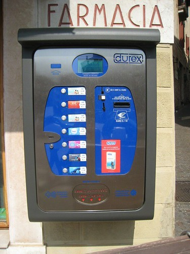ondom vending machine on italian street corner