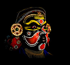 Demon in Disguise (SidhArcheR) Tags: portrait india streetart color art beauty yellow contrast canon artist artistic fineart kerala talent stunning deviant cwc redface streetphotographer facesofindia peopleofindia beautifulindia 1000d peoplephotographer indiantalent stunningphotogpin travelphotographerfromindia peoplephotographerfromindia