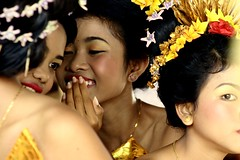 rumpi (Farl) Tags: travel bali colors neck indonesia dancers candid ceremony smiles culture framing hindu hinduism saraswati gossip headdress