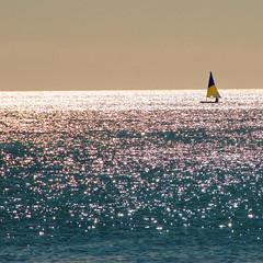 A l'autre bout du monde (Pixelinthebox) Tags: sea sun reflection nikon holidays alone sailing quiet peace mauritius 2007 questfortherest d80 àlautreboutdumonde