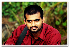 Which is your pick? (Rahul Sadagopan) Tags: red portrait india male guy nikon head indian d70s shoulder southindia southindian 300mmf4afs rahulsadagopan dsc9772