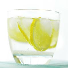 Lemonade and Ice (sneige) Tags: ice glass yellow lemonade onwhite turqoise