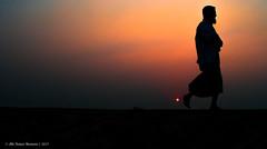 | LEAVE THE DAY BEHIND | (iam_aanwar) Tags: man sun roadside outdoor evening red yellow bangladesh walk