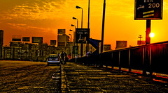 Friday early morning (KoRaYeM) Tags: street bridge people orange sun cars car yellow clouds digital sunrise buildings river ads square geotagged rebel xt traffic panel banner eid egypt nile cairo 200 parked meter exit banners digitalrebelxt hdr hdri advertisments lightroom photogallery tahrir 3xp photomatix flickrexplore 6october aeb flickrelite korayem geo:lat=30049147 geo:lon=31229538