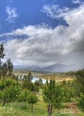 Entorno del Pantano de La Viuela (carloscASTROweb) Tags: road blue sky cloud costa lake tree
