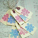 pink and blue flower tags