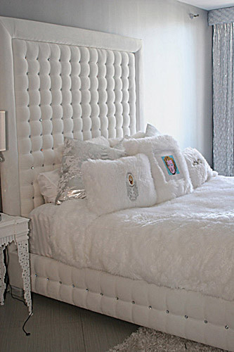 white velvet tufted bed with crystals