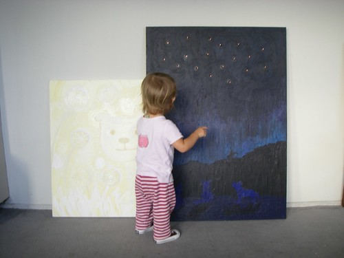 Baby Bug inspects the paintings that came back home
