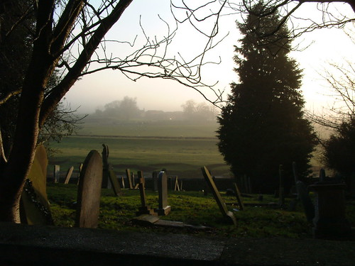 A graveyard, one foggy morning