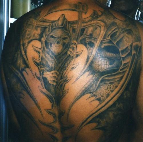 Las piernas a continuaci 243 n una foto de un tatuaje de la santa muerte