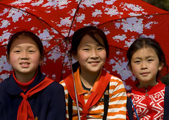 I hope the North Koreans love their children too (Eric Lafforgue) Tags: park travel girls red smile kids del umbrella children happy kid asia republic child propaganda smiles sunny korea il kimjongil korean socialist asie coree enfant norte northkorea 3girls nk ideology axisofevil pyongyang dictatorship  eastasia sung  corea dprk  stalinist juche kimilsung northkorean 6283 lafforgue kimjungil  democraticpeoplesrepublicofkorea  ericlafforgue  koreanpeninsula  coreadelnord   coreedusud dpkr northcorea juchesocialistrepublic eastasiaasie coreedunord rdpc koreankim jongilkim peninsulajuche  stalinistdictatorship jucheideology kimjongilasia insidenorthkorea   demokratischevolksrepublik