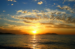 before the night (esther**) Tags: sunset sea sky sun reflection beach colors yellow clouds island golden bravo hellas greece grecia shore sublime griechenland rhodes interestingness11 ellada xoxox interestingness10 interestingness411