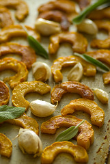 roasted delicata (mwhammer) Tags: stilllife food orange white color green texture metal ceramic display object sage squash garlic plates roasted propstyling top20foodmmmm foodstyling melinahammer tabletopstyling