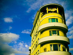 yellow orange (pucc) Tags: city blue windows sky urban italy rome color roma building colors yellow architecture clouds digital xpro cross blu acid crossprocessing canons70 fakexpro pucc
