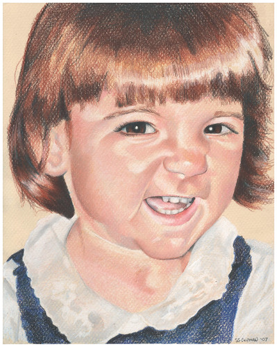 Colored pencil portrait of my daughter grinning like a loon.