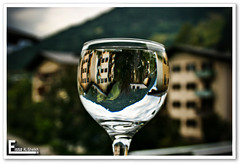 VillaGe iN mY GlaSs cUp ~! (Essa Al-Sheikh - @Bo3awas) Tags: sky cup glass clouds canon lens eos austria see am village apartment 1855mm zell the wolrd my xti 400d aplusphoto
