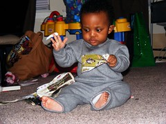 I am No. 5... Destroyer of MAGAZINES! (deidra_morrison) Tags: baby playing cute kid fuji finepix napoleon hanging fujifilm s700 s5700