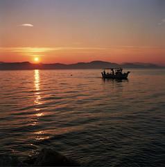 Fishing boat at Kiveri (Ed Chadwick) Tags: tlr film water sunrise boat kodak greece portra 160nc kalloflex kiveri placefolio