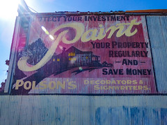 Paint Your Property (Steve Taylor (Photography)) Tags: polsons paint advert art building black cerise yellow blue house metal iron newzealand nz southisland canterbury christchurch cbd city corrugated sunshine sunny sun