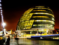 London's City Hall (` Toshio ') Tags: greatbritain england people woman building london window rain yellow thames architecture night lights europe nightshot mayor unitedkingdom cityhall perspective royal southbank boardwalk raining royalty europeanunion southwark gla greaterlondonauthority toshio