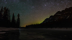 Aurora Hide and Seek (WherezJeff) Tags: winter friends mountain canada green castle river stars alberta bow banff nightshots headlamp auroraborealis