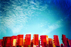 festival flags (lomokev) Tags: red sky orange color festival clouds cosina glastonbury flags glastonbury2004 cosinacx2 cx2 anguswatt file:name=pear21