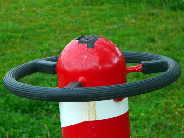A red thingy in a playground.