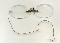 Rimless fingerpiece pince-nez with earloop and chain circa 1910's (pince_nez2008) Tags: nose glasses eyeglasses lenses eyewear eyeglass rimless nosebridge noseglasses pincenez noseclip pincenezwithearloop earloop noseeyeglasses fingerpiece