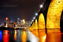 Minneapolis at night (jpnuwat) Tags: longexposure bridge light reflection water minnesota skyline night river downtown minneapolis mississippiriver twincities 1870mm d300 stonearchbridge dsc2929 04102008
