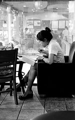 "Reading in a Cafe - Bangkok (Sailing ""Footprints: Real to Reel"" (Ronn ashore)) Tags: people blackandwhite film portraits bangkok leicamp aplusphoto leicasummicron35mmf20asph earthasia thereader3 bloggedonminibookexpocom"