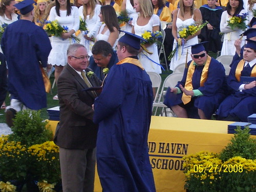 Bear getting his diploma