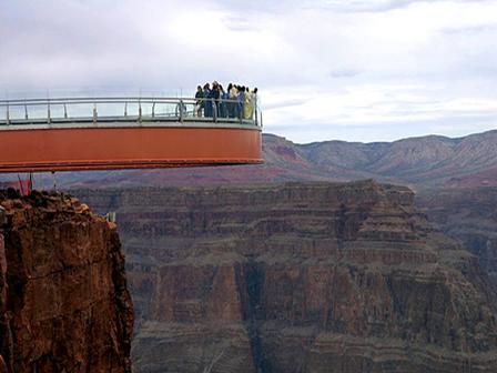 See how the Grand Canyon Skywalk juts 70 feet over the west rim of the Grand Canyon