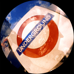 Mind the gap (Mas-Luka) Tags: city travel red sky london station sign underground subway lomo lomography europa europe novembre symbol blu doubleexposure trafalgarsquare cielo transportation cartello rosso londra nelsonscolumn 2007 doppiaesposizione businesstravel simbolo urbanscene fiheye peopletraveling