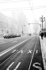 Arrivo alla partenza (bogob.photography) Tags: auto blackandwhite bw white black cute car station train geotagged concrete interesting europa europe strada taxi bn most lane nikkor asphalt asfalto stazione bianco treno nero 1870mm 1870 treni portanuova f3545 f3445 peoplesfavorites 2008nikond80torinoturinitalyitalianikkor