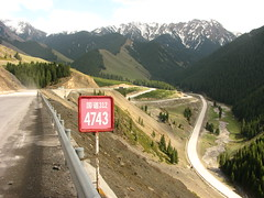 Steep tough climb up 2200m high pass near Santai, Xinjiang Province, China