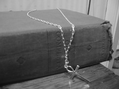 Gothic reading (LordGK) Tags: blackandwhite book cross melancholy ankh poe