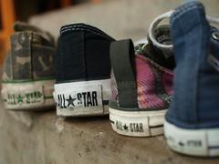 Family of All Stars (sassylittlelulu) Tags: olympus converse allstars fgr e420 mamashoe onthefrontsteps olympuse420 25mmpancake ashoefromeachofyourcollections daddyshoe littleboyshoe babygirlshoe