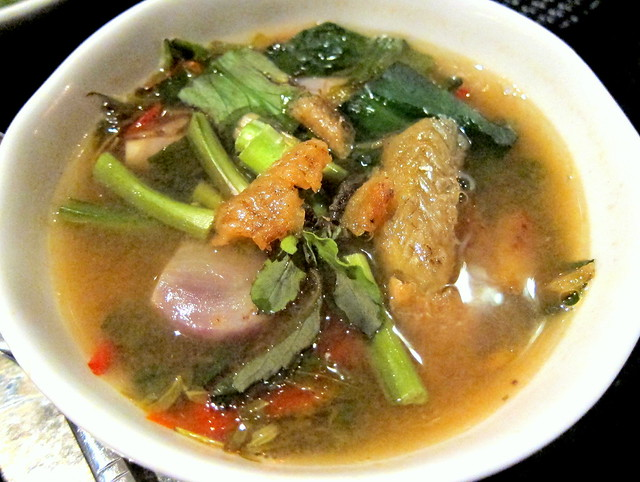 Dtom klong bai makam sai pla grob (Spicy soup infused with smoked fish and young tamarind leaves)