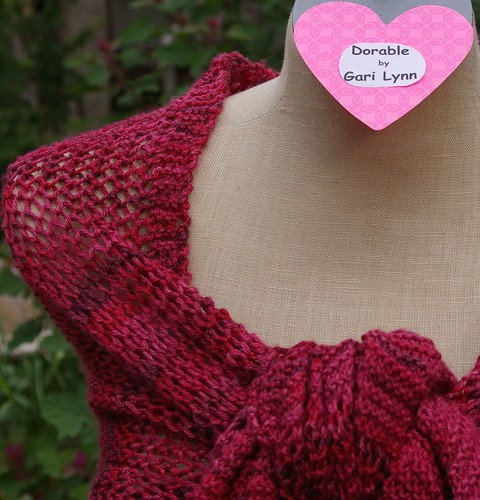 Dorable with heart label wrapped as shawl knot in front showing right shoulder