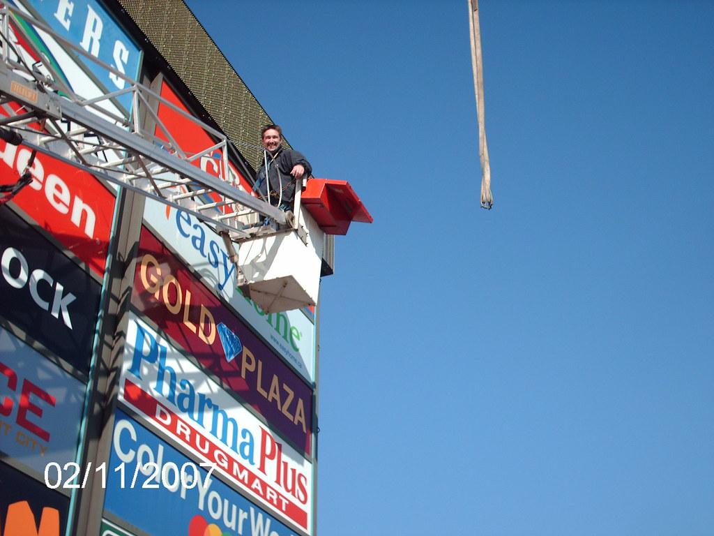 wehangsigns.com signworks inc crane bucket sign install installation neon repair led re-vamp retrofit retro fit neon sign box awning service call work order fix lights pole lights lamp post mh hps met