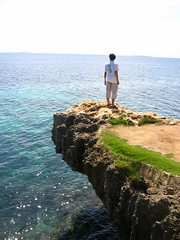 In Retrospect (Ngoch!!) Tags: ocean sea beach rock relax person sand thought horizon philippines cebu imagine concentrate retrospect cebusugbo